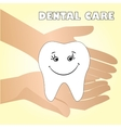 Hands holding a healthy tooth vector image