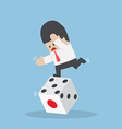 Businessman standing on unstable dice vector image