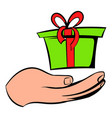 gift red box in a hand icon icon cartoon vector image