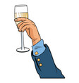 hand with champagne cup pop art vector image