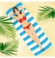 woman in bikini lying on colorful beach towel vector image