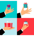 hand holding small gift box set vector image