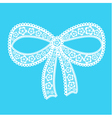 Decorative lacy bow on blue background vector image