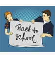 Pupils hold poster with back to school sign vector image