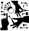hands holding key black silhouette set vector image