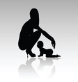 woman with baby silhouette vector image