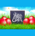 red eggs in a field of grass with blue sky happy vector image