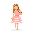 cute girl in pink dress drinking a fresh juice vector image