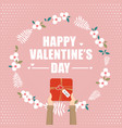 hand holding gift box for valentines day vector image