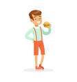smiling boy eating hamburger colorful character vector image