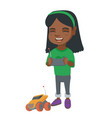 african girl playing with a radio-controlled car vector image
