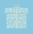 gift box made from white snowflakes on blue vector image