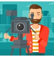 Cameraman with movie camera on a tripod vector image