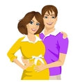 husband touching the belly of his pregnant wife vector image