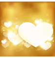 Golden glowing love heart background with lights a vector image