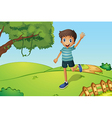 A happy boy waving while running in the hill vector image