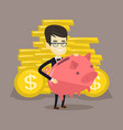business man holding big piggy bank vector image