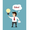 Smiling cartoon businessman with a light bulb vector image vector image