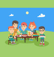 group of caucasian children having fun at picnic vector image