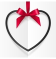 Black heart shape frame hanging on red silky vector image vector image