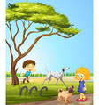 Children playing with dogs in the park vector image vector image