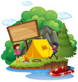 wooden sign behind the camping site vector image vector image