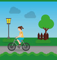 cheerful woman riding a bike on a park road vector image