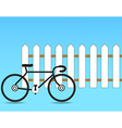 Fence with a bicycle vector image