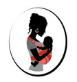 woman is holding a baby in a sling vector image