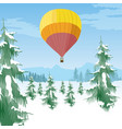 air balloon flying over forest in snowy valley vector image