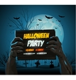Zombie hands holding a halloween poster ad vector image