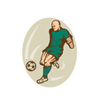 Soccer player running and kicking the ball vector image