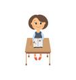 flat schoolgirl sitting at desk isolated vector image