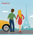 young couple looking at eiffel tower in paris vector image