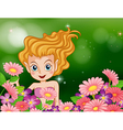 A happy fairy at the garden with colorful flowers vector image