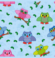 seamless pattern with ornamental owls over blue vector image