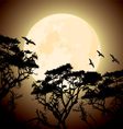 big yellow moon and silhouettes of tree branches vector image