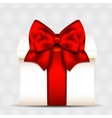 Gift box with red bow on christmas background vector image