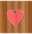 Torn paper heart pinned on wooden background vector image