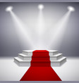 Illuminated stage podium with red carpet vector image