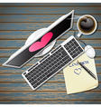 top view of computer and note paper with hot coffe vector image