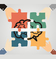 hands putting piece into brain shaped puzzle vector image