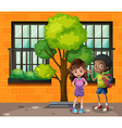 Boy and girl standing on the street vector image