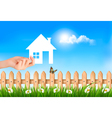 The house in hand on green natural background vector image