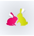 Couple of paper rabbits on a white background vector image