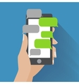 Hand holding smartphone with blank speech bubbles vector image
