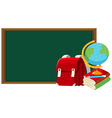 Blackboard and other school objects vector image