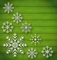 Set geometric snowflakes on wooden background vector image