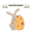 Cute bunny holding Easter Egg vector image
