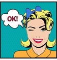 Pop art winking woman with ok speech bubble vector image